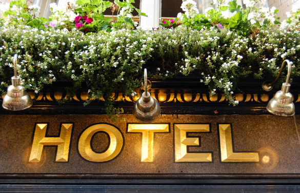 golden-hotel-sign-close-up-shutterstock_219379825-2-585x376