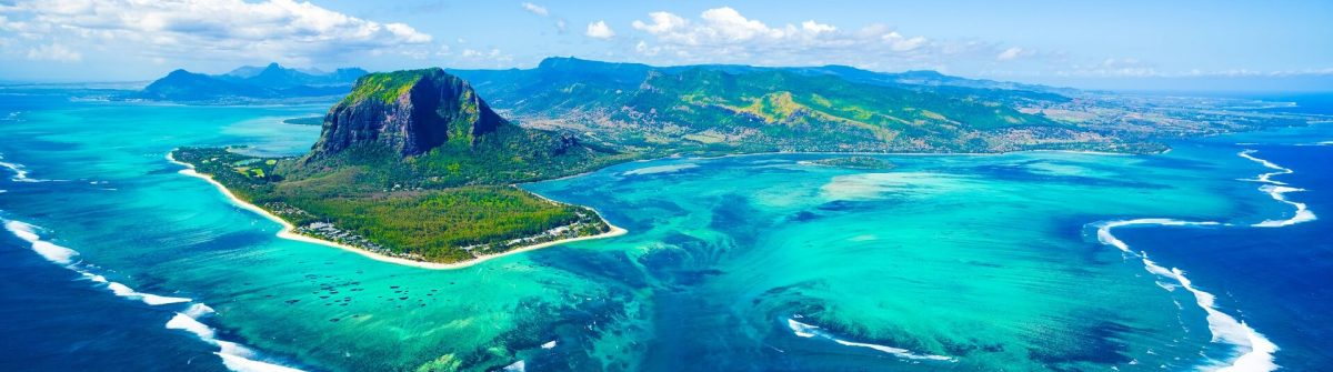 Aerial-view-of-Mauritius-island-panorama-and-famous-Le-Morne-Brabant-mountain-beautiful-blue-lagoon-and-underwater-waterfall-shutterstock_733185379