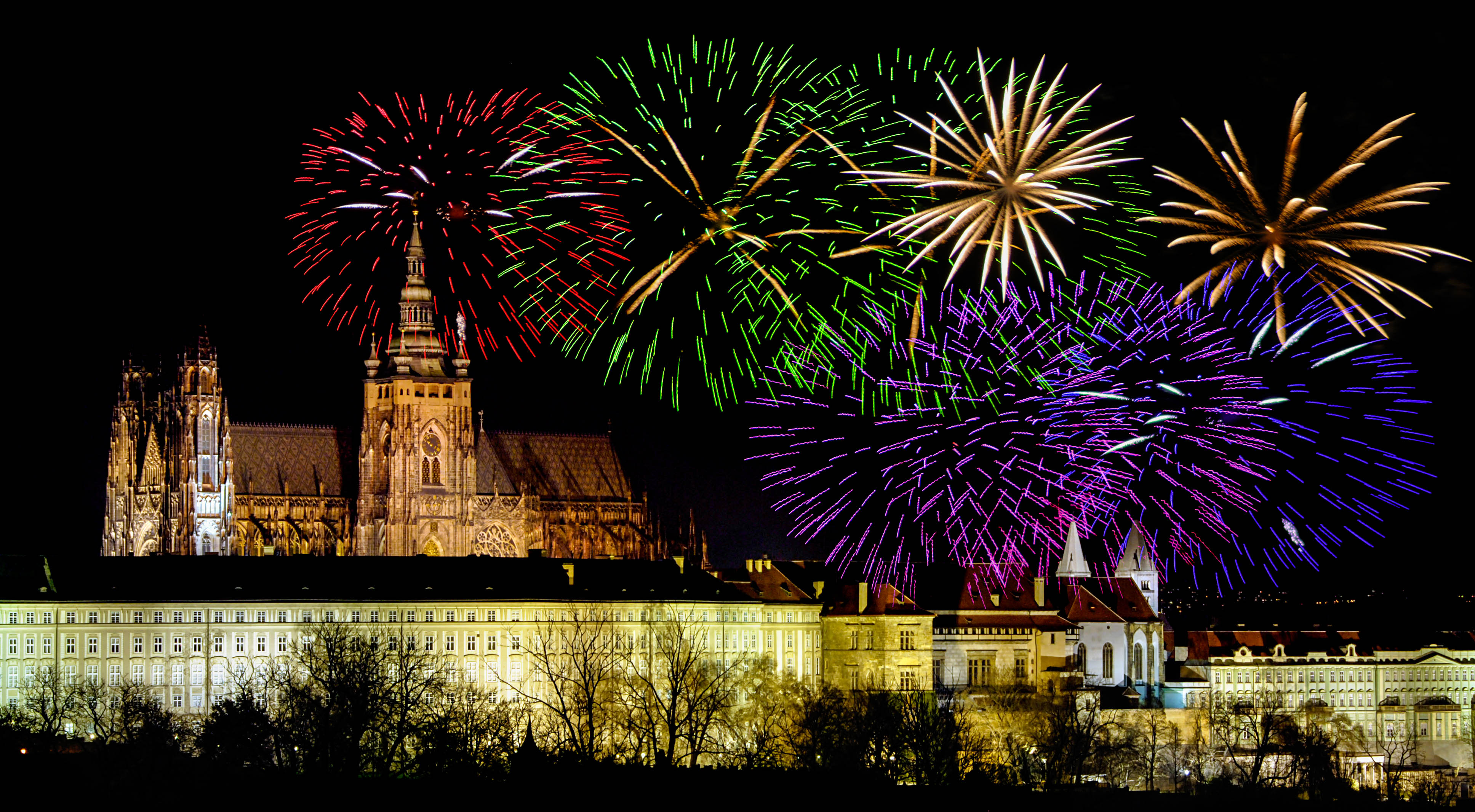 Prague castle in the night - residence of czech president and colorful fireworks during the New Year celebrations