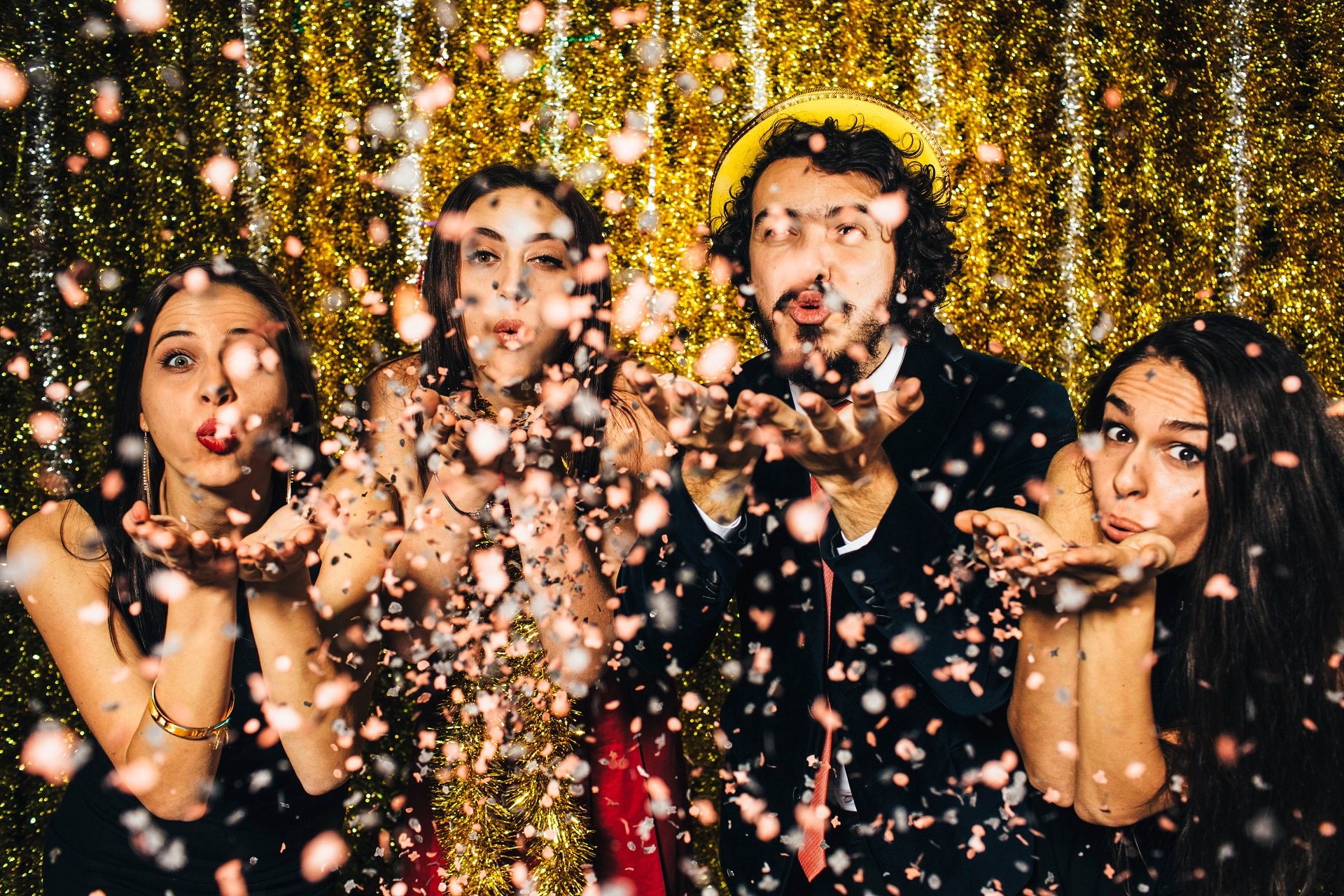 Friends blowing confetti on New Year's Eve - 2016.
