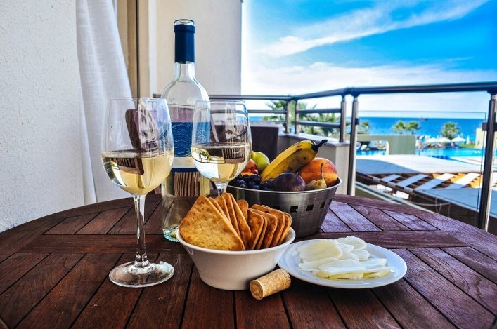 wine-with-snack-on-a-background-of-the-sea-istock_000067897009_medium-2-1