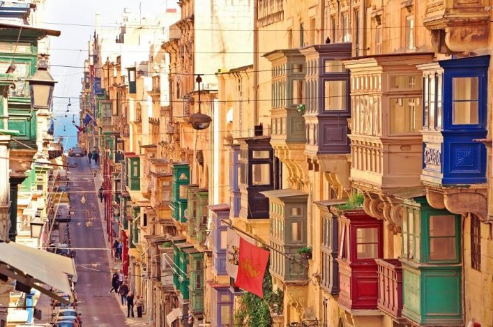 Famous-landmark-of-hilly-road-with-colourful-balconies-in-the-ancient-city-of-Valletta-Malta-shutterstock_728322313