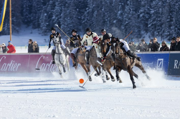 Polo Players Chase Ball