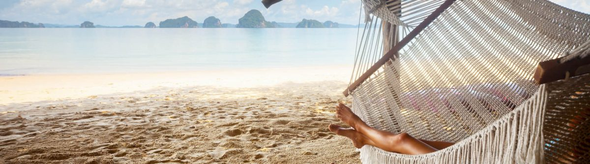 girl_at_the_beach_hammock_shutterstock_235622767_1920