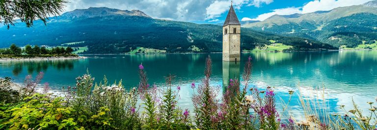 bell-tower-of-the-reschensee-resia-south-tyrol-italy-shutterstock_314553227-2