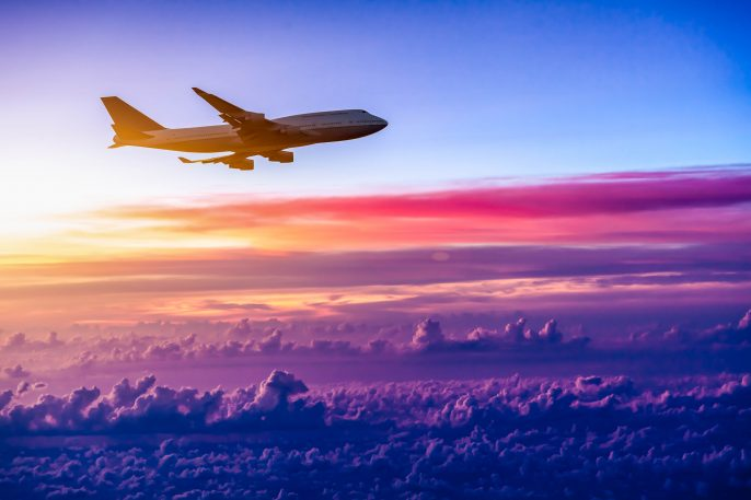 Airplane-in-the-sky-at-sunrise-shutterstock_209155915-2