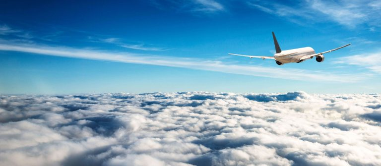 commercial-airplane-plane-flying-on-the-clouds-iStock_70565965_XLARGE-2