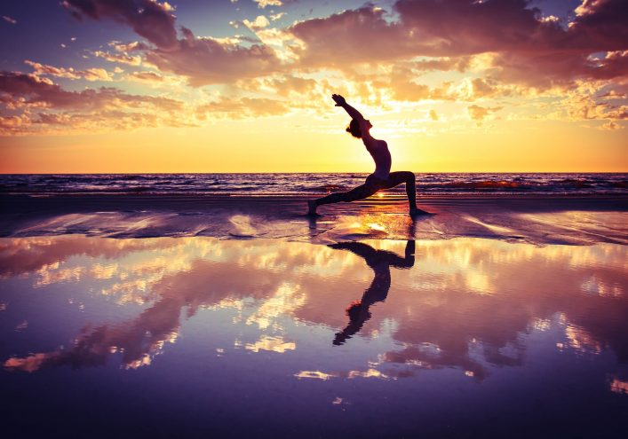 silhouette-of-woman-practicing-yoga-on-the-beach-at-sunset-shutterstock_304371815-2