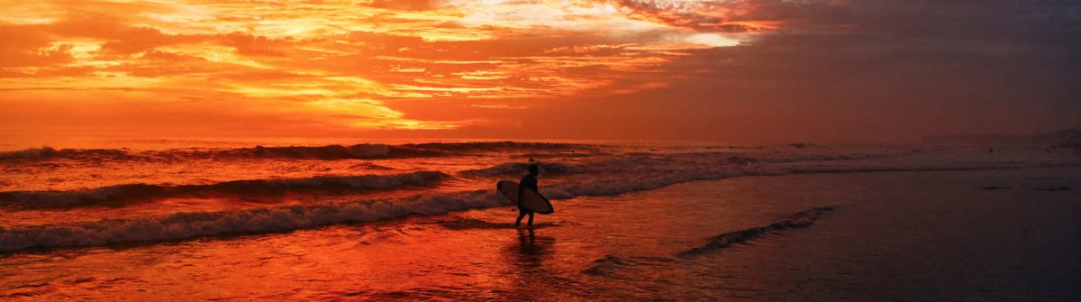 A-beautiful-sunset-at-one-of-the-beaches-of-Canggu-Bali-Indonesia_shutterstock_1374758384