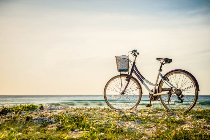 bicycle-parked-in-paradise-island-shutterstock_149302079-2-1