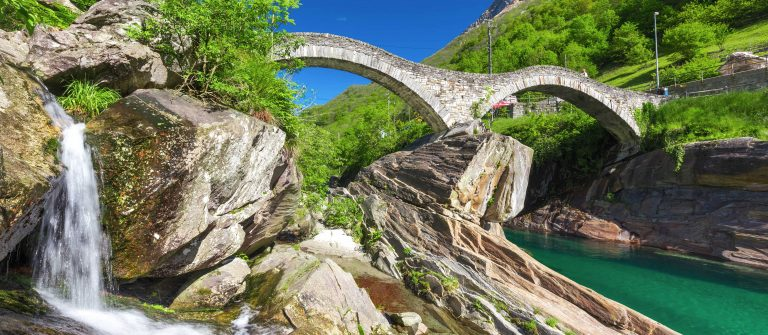 double-arch-stone-bridge-at-ponte-dei-salti-with-waterfall-lavertezzo-verzascatal-canton-tessin-shutterstock_430079833-2