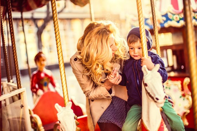 Mommy-and-me-on-a-carousel-ride-iStock_000065226925_Large-2