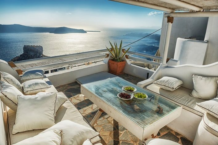 Traditional-Greek-Cafeteria-with-View-of-Volcano-and-Santorini-iStock_000068076721_Large