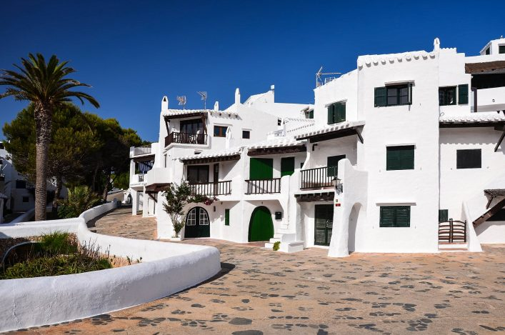 typical-whitewashed-houses-in-village-of-binibequer-vell-menorca-balearic-islands-spain-shutterstock_107586938-2