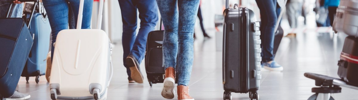 Passengers walking in the airport terminal