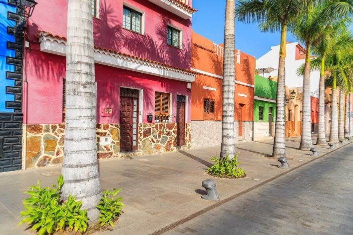 Colourful-houses-and-palm-trees-on-street-in-Puerto-de-la-Cruz-town-Tenerife-Canary-Islands-Spain-shutterstock_3414625011