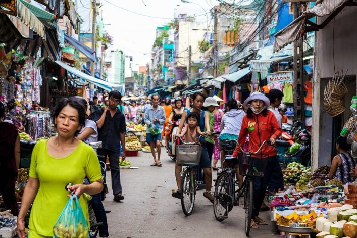 crowded-marketplace-with-street-vendor-in-ho-chi-minh-city-vietnam-shutterstock_62087224-editorial-only-stephen-bures-2