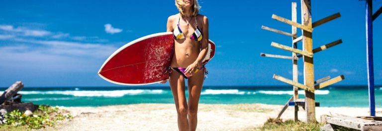 surfer-girl-Bali-iStock_000023859243_Large-2