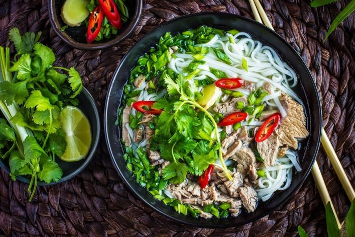 traditional-vietnamese-soup-pho-with-beef-and-rice-noodles-top-view-shutterstock_397328149-2
