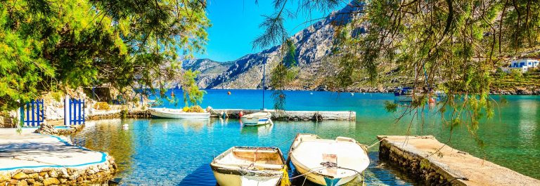 Haven with boats in sea bay , Greece