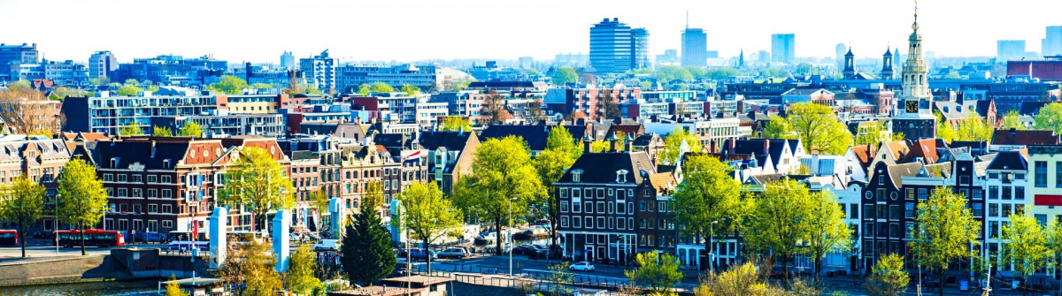 Aerial-View-of-Amsterdam-city-on-One-Beautiful-Sunny-Day-iStock_000036179194_Large-2