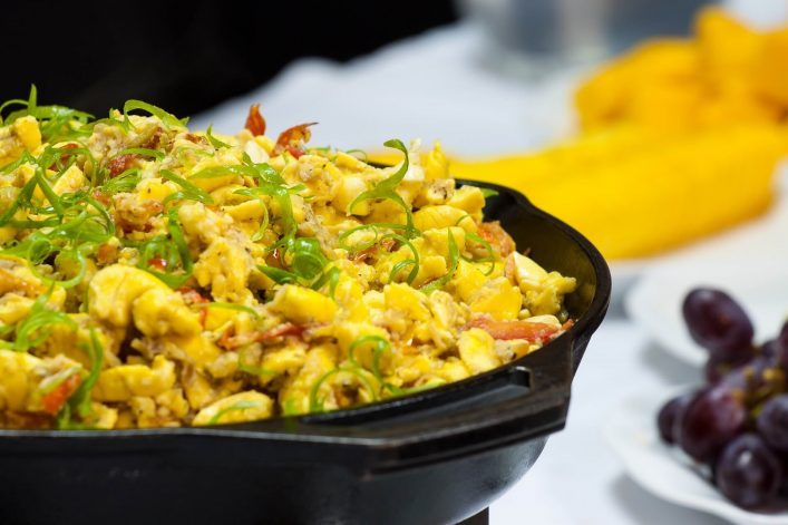 Ackee-and-Salt-fish-Breakfast-served-with-assorted-fruits-and-fried-bammies-shutterstock_649546603