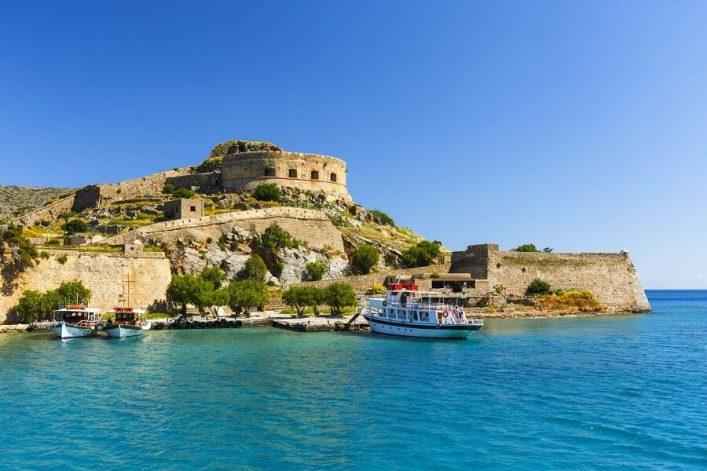 Historical-site-of-Spinalonga-island-on-a-sunny-spring-day-Crete-Greece_shutterstock_651408517