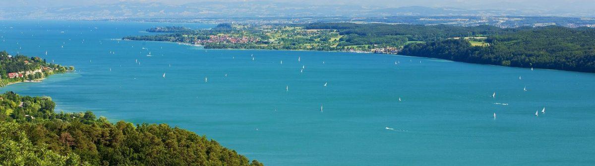 View-on-Lake-Constance-Bodensee-with-blue-sky-and-the-Alps-in-background_shutterstock_93414991