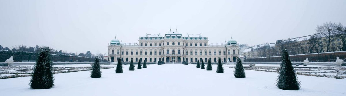 The-Belvedere-palace-of-Vienna-in-winter-time-with-snow-covered-park-in-front_shutterstock_379611274