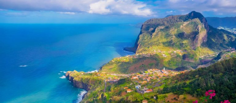 Aerial-view-over-Faial-city-fort-and-Santana-region-on-the-ocean-coast-of-Madeira-island-Portugal.-shutterstock_1099470197