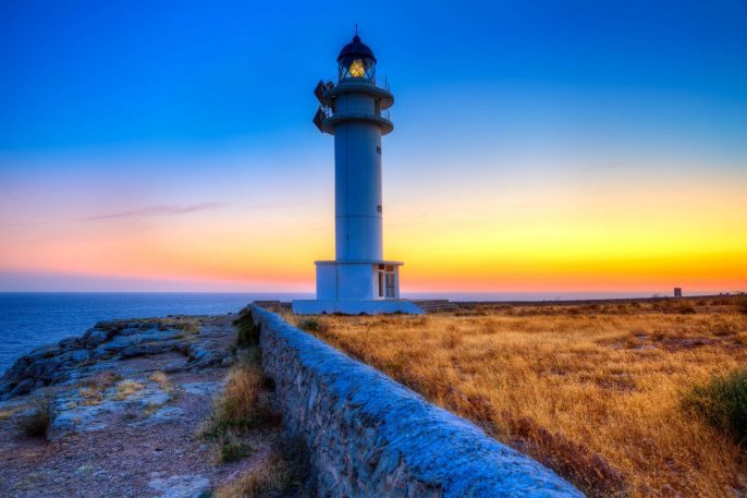 Formentera-sunset-in-Barbaria-cape-lighthouse-at-Balearic-Mediterranean-islands-shutterstock_185531699-2