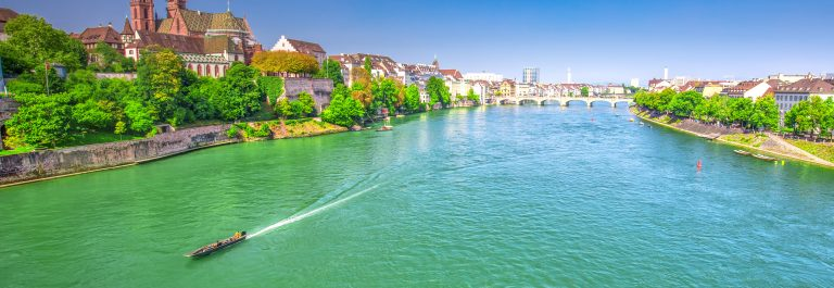 Old-city-center-of-Basel-with-Munster-cathedral-and-the-Rhine-river_shutterstock_725300011