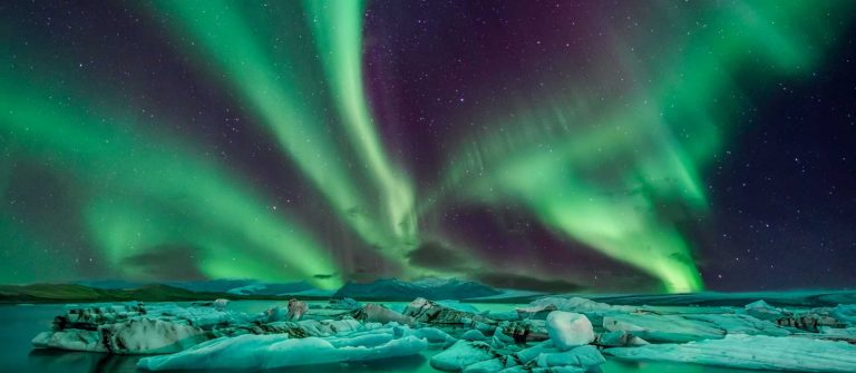 A-wonderful-night-with-Kp-5-northern-lights-flying-over-the-Glacier-Lagoon-in-iceland_shutterstock_527458129
