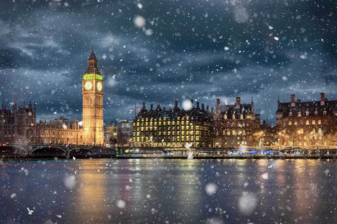 Big-Ben-and-Westminster-on-a-cold-winter-night-with-falling-snow-London-United-Kingdom_shutterstock_714423985