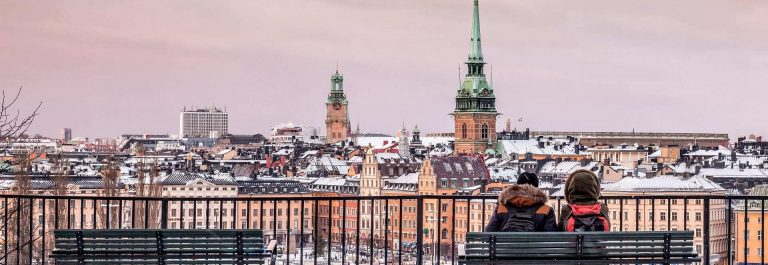 Lovers-at-the-hill-are-looking-over-the-Stockholm-Old-Town_shutterstock_359230625_1920x1280