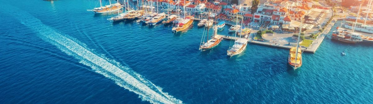 Aerial-view-of-boats-yahts-floating-ship-and-beautiful-architecture-at-sunset-in-Marmaris-Turkey-shutterstock_1070943806_1920