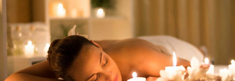 Peaceful scene of a woman at spa and beauty salon / candle light