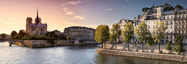 Notre-Dame-cathedral-on-Ile-de-la-Cite-in-Paris-France-seen-from-the-Tournelle-Bridge-over-River-Seine.-Part-of-Saint-Louis-Island-on-the-right_shutterstock_128910458x2000