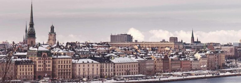 Vintage-tinted-snapshot-Winter-view-over-strait-of-Stockholm-downtown.-Boat-on-the-water.-Sweden_shutterstock_420343180