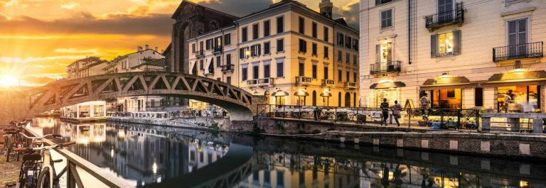 Bridge-across-the-Naviglio-Grande-canal-at-the-evening-in-Milan-Italy-shutterstock_316886099-2