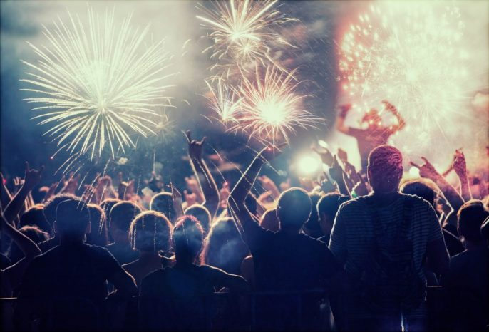 Crowd watching fireworks and celebrating New Year
