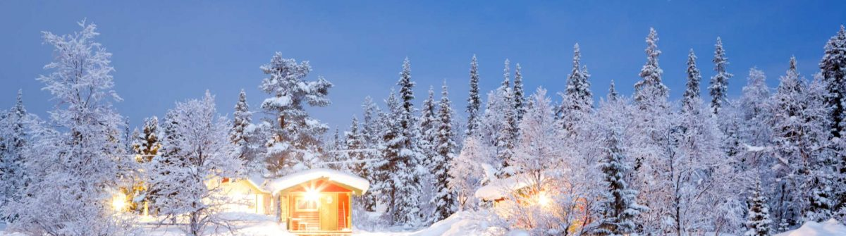 Winter-landscape-with-cabin-hut-at-night-in-Kiruna-Sweden-at-Night-with-star-trail_shutterstock_138524561
