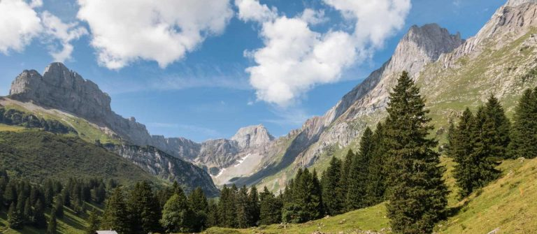 glacial-valley-in-Glarus-Alps-Switzerland-with-blue-sky-and-copy-space_shutterstock_1558120529