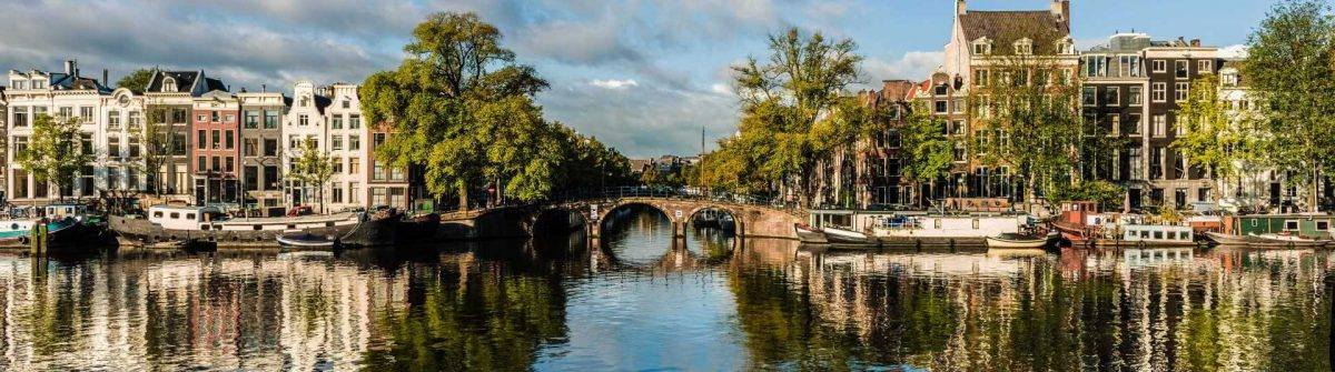 Amstel-Canal-Houses-in-Amsterdam-Netherlands-iStock_75083593_1920X1280
