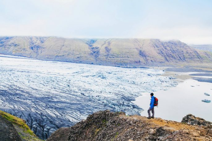 Backpacker-looking-at-the-view-of-glacier-in-Iceland.-iStock-623608476-1