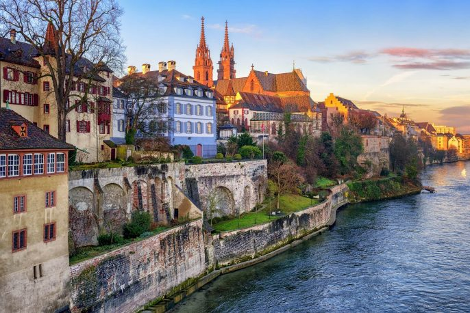 Old-town-of-Basel-with-red-stone-Munster-cathedral-on-the-Rhine-river-Switzerland_358181183