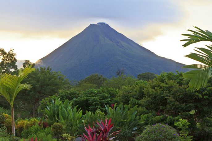 A-lush-garden-in-La-Fortuna-Costa-Rica-with-Arenal-Volcano-in-the-background_shutterstock_101362975