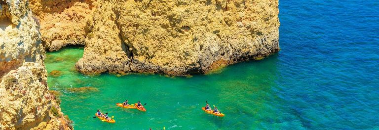 Kayaks-in-sea-bay-on-turquoise-sea-water-on-coast-of-Portugal-shutterstock_369612809-1