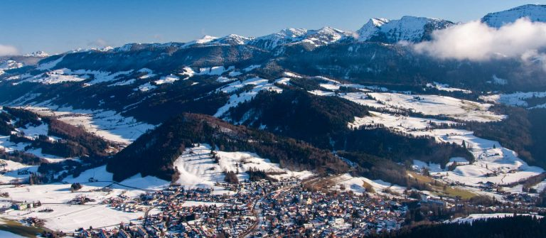 Aerial-view-of-the-City-of-Oberstaufen-in-winter-in-Allgaeu-in-Germany_shutterstock_1630060042
