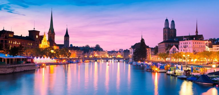 Zurich-Skyline-and-the-River-Limmat-in-the-Evening_shutterstock_100632295_1920-1